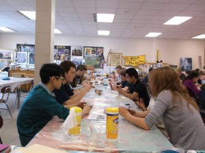 arts and crafts students working with middle school students